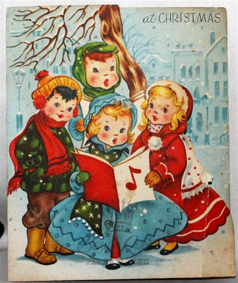 cards of concern during christmas children singing carols songbook snowing vintage