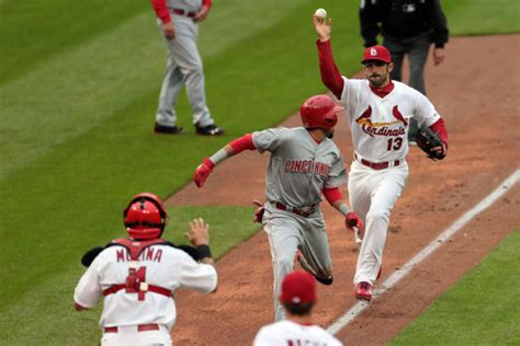 cards run reds in home opener st louis cardinals