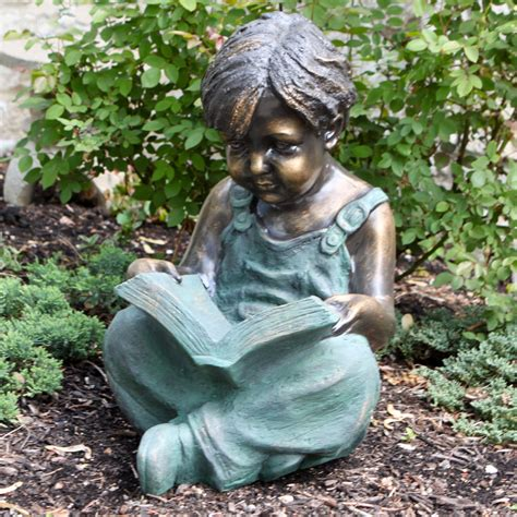 garden statues alpine boy sitting reading book garden statue