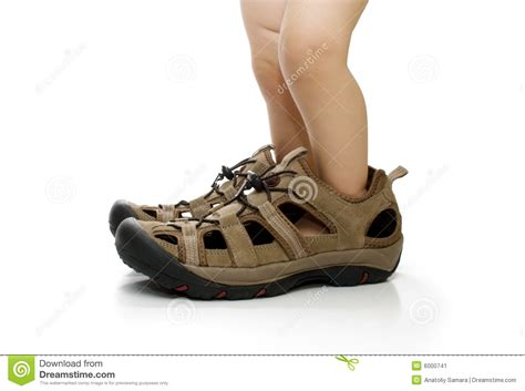 shoes for with big baby in big shoes isolated stock image image