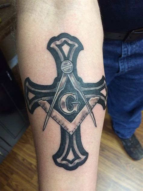 black and grey cross tattoo 14 masonic tattoos on forearm