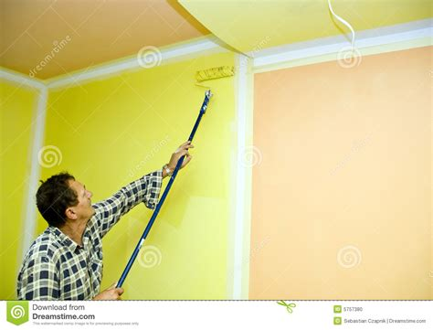 Is It Bad To Paint A Room While by Roller Painting In Yellow Stock Photo Image 5757380