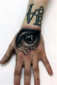 best hand tattoos top 50 best hand tattoos for men fist designs and ideas