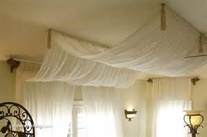 how to hang drapes from the ceiling drape curtains on ceiling over bed pretty this could