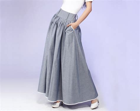 gray pleated maxi skirt with white piping detail 557