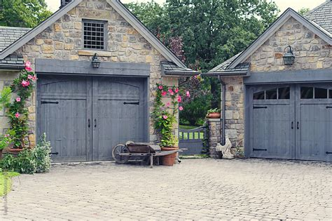 Cottage Garage Doors Cottage Garage Doors With Gate Between By Leigh Stocksy United