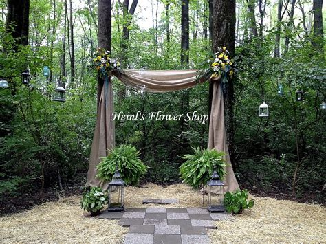 Outdoor wedding arch or burlap with flowers and boston