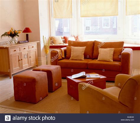 terracotta living room modern livingroom with terracotta sofa and upholstered stools and stock photo royalty free