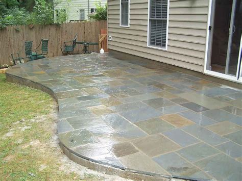 Cut Flagstone Patio by Bedding Bulldawg Yards