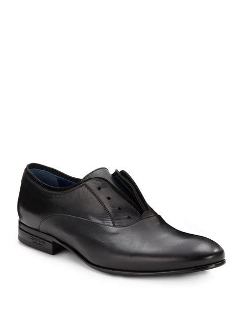 calvin klein suede trimmed laceless leather shoes in black