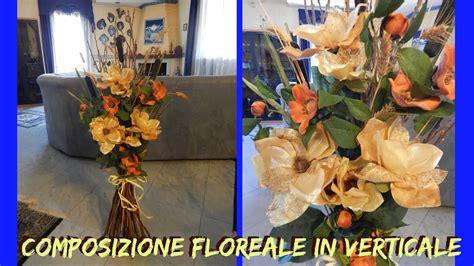 rami di fiori composizione di rami e fiori artificiali in verticale