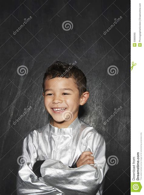 costume with arms smiling boy in silver costume with arms crossed stock photo image 33889060