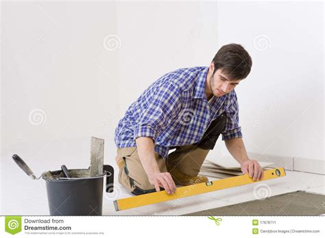 home tile improvement handyman with level stock image