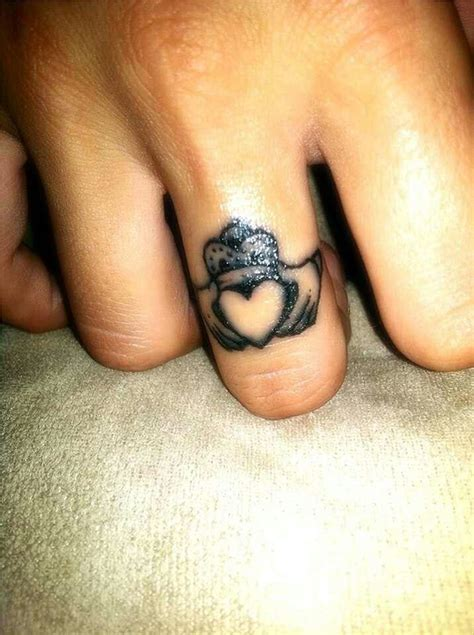 claddagh ring tattoo designs make a rocking by astonishing ring tattoos