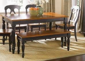 Home low country black 6 piece set with napoleon back side chairs
