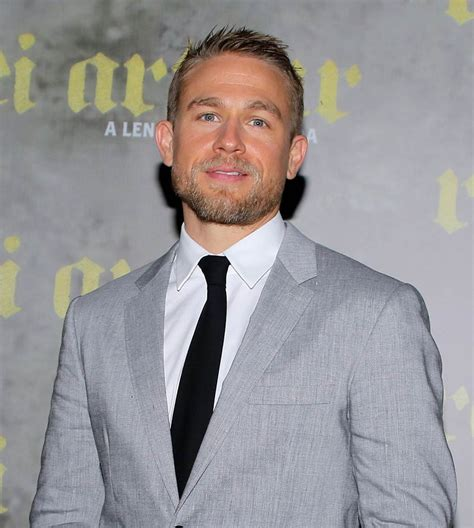 charlie hunnam charlie hunnam s king arthur flop saved by strong