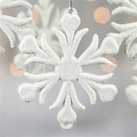 white glittered snowflake ornaments snow snowflakes
