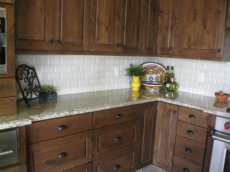 what color subway tile with oak cabinets venetian gold granite with a cream beveled subway tile