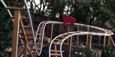 backyard wooden roller coaster this dad built a roller coaster in his backyard for his