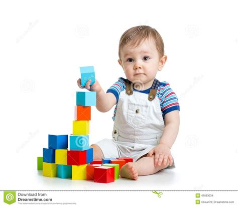 How To Build A Baby - baby toddler building block toys stock photo