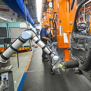 robots lend an arm to automotive workers