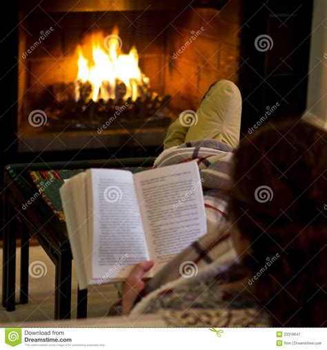 By The Fireplace by Reading By Fireplace Royalty Free Stock Photography