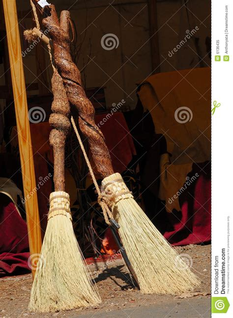 Handcrafted Brooms - unique handcrafted brooms royalty free stock photo image