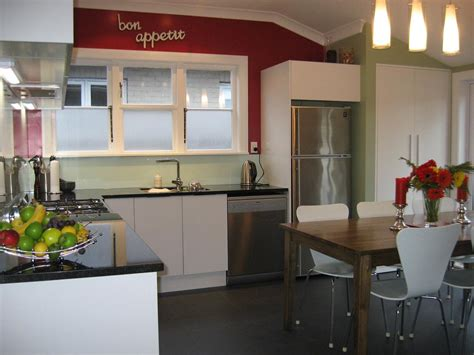 White units with black granite bench top and red walls