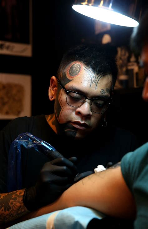 tattoo concealer singapore blackout tattoos gaining popularity worldwide singapore