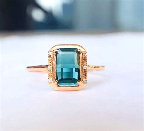 Green Tourmaline 5 25 Ct 18kt gold ring with blue green tourmaline 1 25ct and