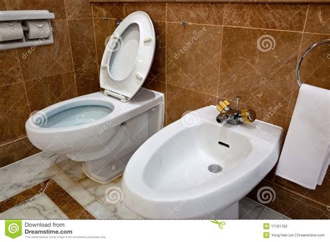 toilet bowl with bidet toilet and bidet in hotel bathroom stock photo image