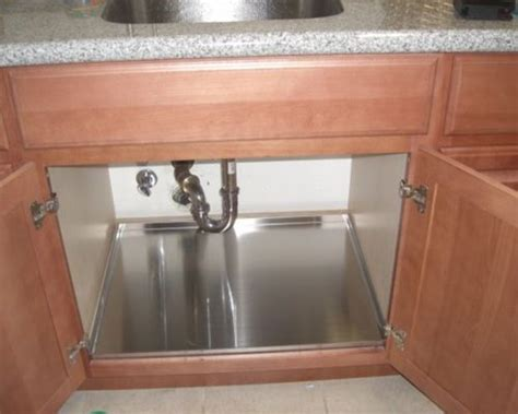 how to protect kitchen cabinets protect your base cabinet with trays
