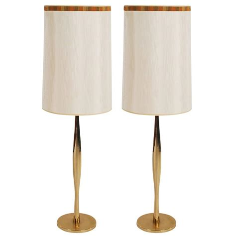Pair of Mid Century Modern Tall Sculptural Brass Table