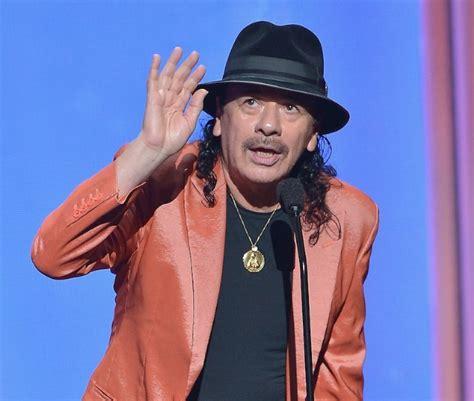 Kaos Carlos Santana 07 carlos santana low key chin checks donald in brief statement vibe