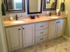 refinished cabinets on cabinets bathroom