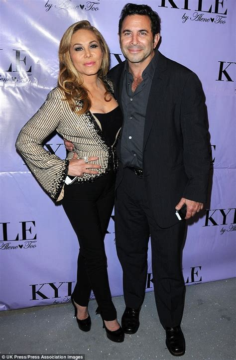 Adrienne Maloof removes her wedding ring  a week after