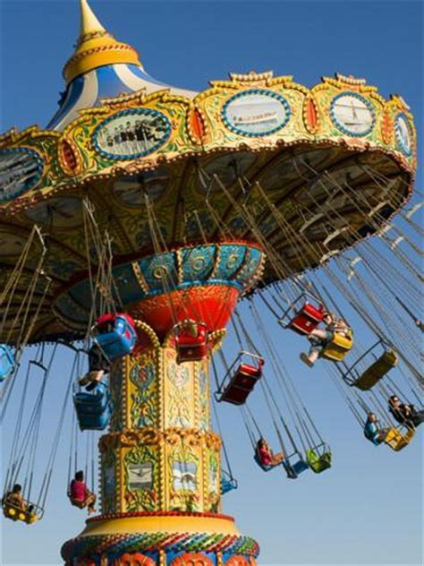 swings at amusement park people riding on sea swings at santa cruz beach boardwalk