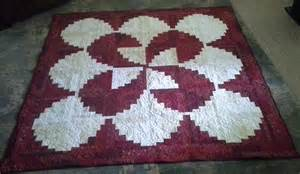 strawberries and curved log cabin quilt