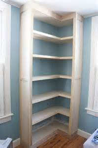 built in corner bookshelves how to build a corner shelf in garage woodworking