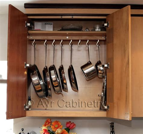 kitchen cabinet organizers for pots and pans pot rack hidden inside cabinet kevin amanda