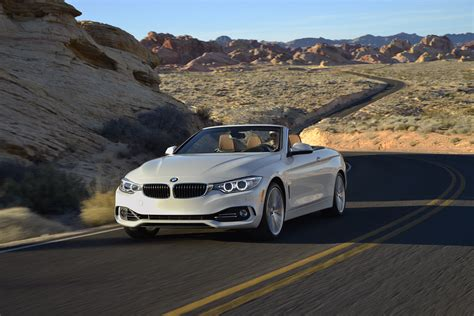 2014 bmw 435i convertible front three quarter in motion 13