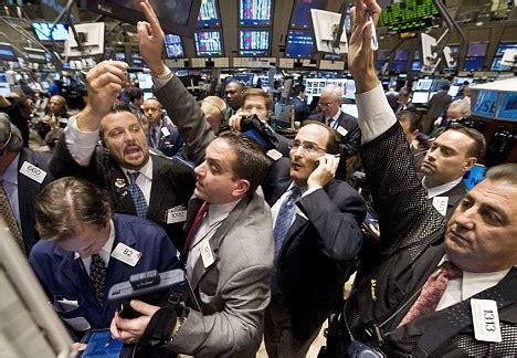 wall street | traders crowd the post that handles morgan