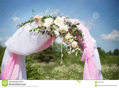 Wedding Arch Tradition by Wedding Traditional Arch With Flower Decor On Blue Sky