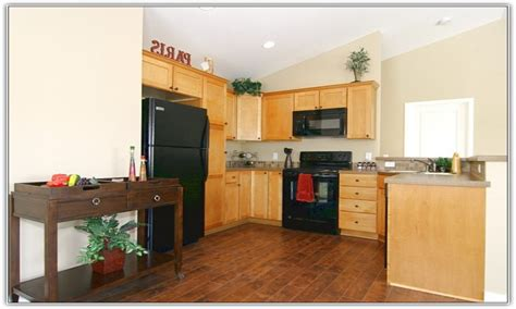 what color wood floor with dark cabinets dark kitchen cabinets with light wood floors dark kitchen