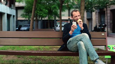 eating bench boy at park with mp3 player stock footage video 1818377 shutterstock