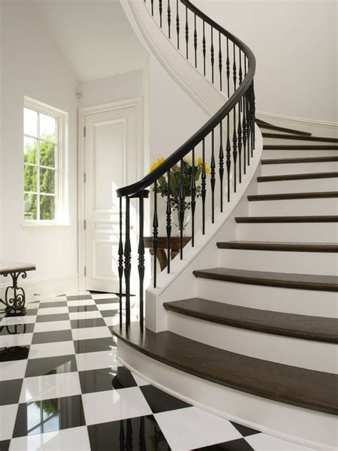 black banister white spindles black and white tile design and stairs stairs