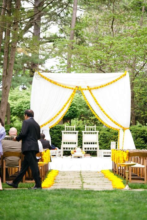 Simple white and marigold outdoor mandap idea, great for a