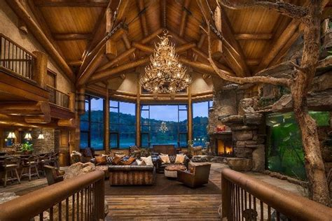 open log home living room with vaulted ceiling and