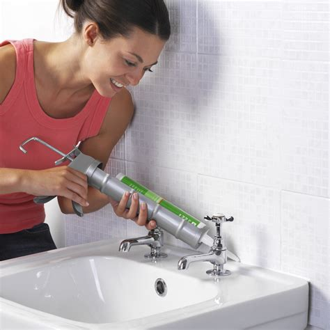 how to reseal bathtub woman caulking sink