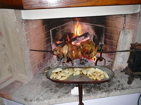 Fireplace Dinner by Dinner On An Open Chicken Quail Turning On A Spit